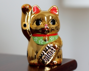 In Japan, the Maneki Neko is the Lucky Cat.