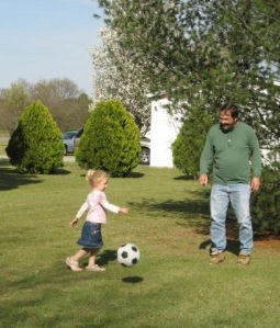 "Our Princess playing soccer with her Cap in 2008.  The littles talk about how he can play soccer again now, in Heaven, and they just hope he's playing ""really good."""