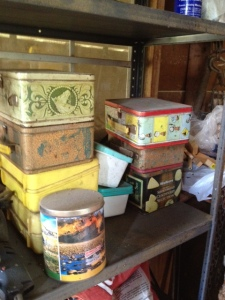 Our old lunchboxes and cookie tins used to store hardware and things he used in fixing cars and lawnmowers or building things with wood