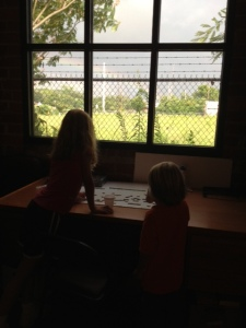 My littles gazing out at the rainbow through the side window at Daybreak