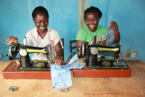 Talented ABAN seamstresses creating beautiful works of art out of water sachets that once littered the street.