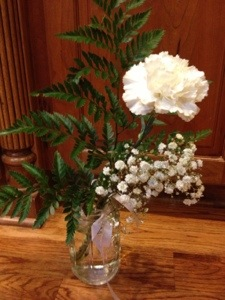 The white carnation given to us during the All Saint's Day service this morning.