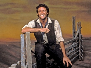 "Hugh Jackman as Curly in ""Oklahoma.""  From http://popwatch.ew.com/2013/11/08/hugh-jackman-oklahoma/"