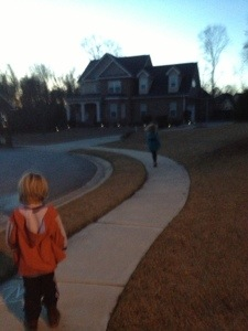 Returning home from our walk--that's our Princess up ahead skipping along.  Cooter even started skipping a few steps later.