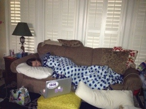 Aub asleep on Cap's brown couch.  Under Cap's argyle blanket we made him.  The argyle was a thing between us.  A precious sight.