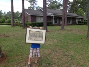 Cooter holding the sketch drawing of the house that was done in 1976.  I am thankful that I have this art to remember this precious home and the love freely given there.