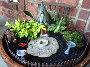 One arm made a lovely backdrop for our fairy garden.