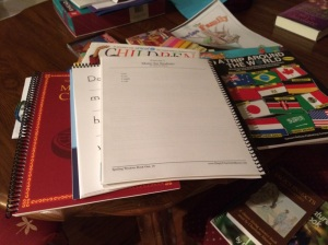 Getting all of our books together for tomorrow.