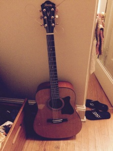 My girl's beautiful, treasured guitar.  Where it belongs, with her, at college, foraging a new path on the journey.