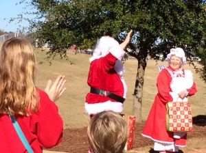The littles welcoming Santa and Mrs. Claus