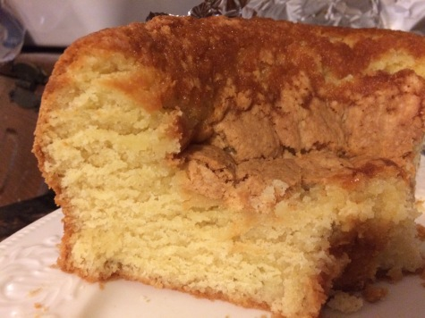 My poor fallen sour cream pound cake.  Some folks around here say they prefer them fallen--they might be telling a tale, but I'm okay with that.