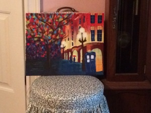 "My painting from across he room.  I can handle y'all seeing this.  It's not perfect, but I rather like it.  ""Tardis in the Rain"" our teacher called it."